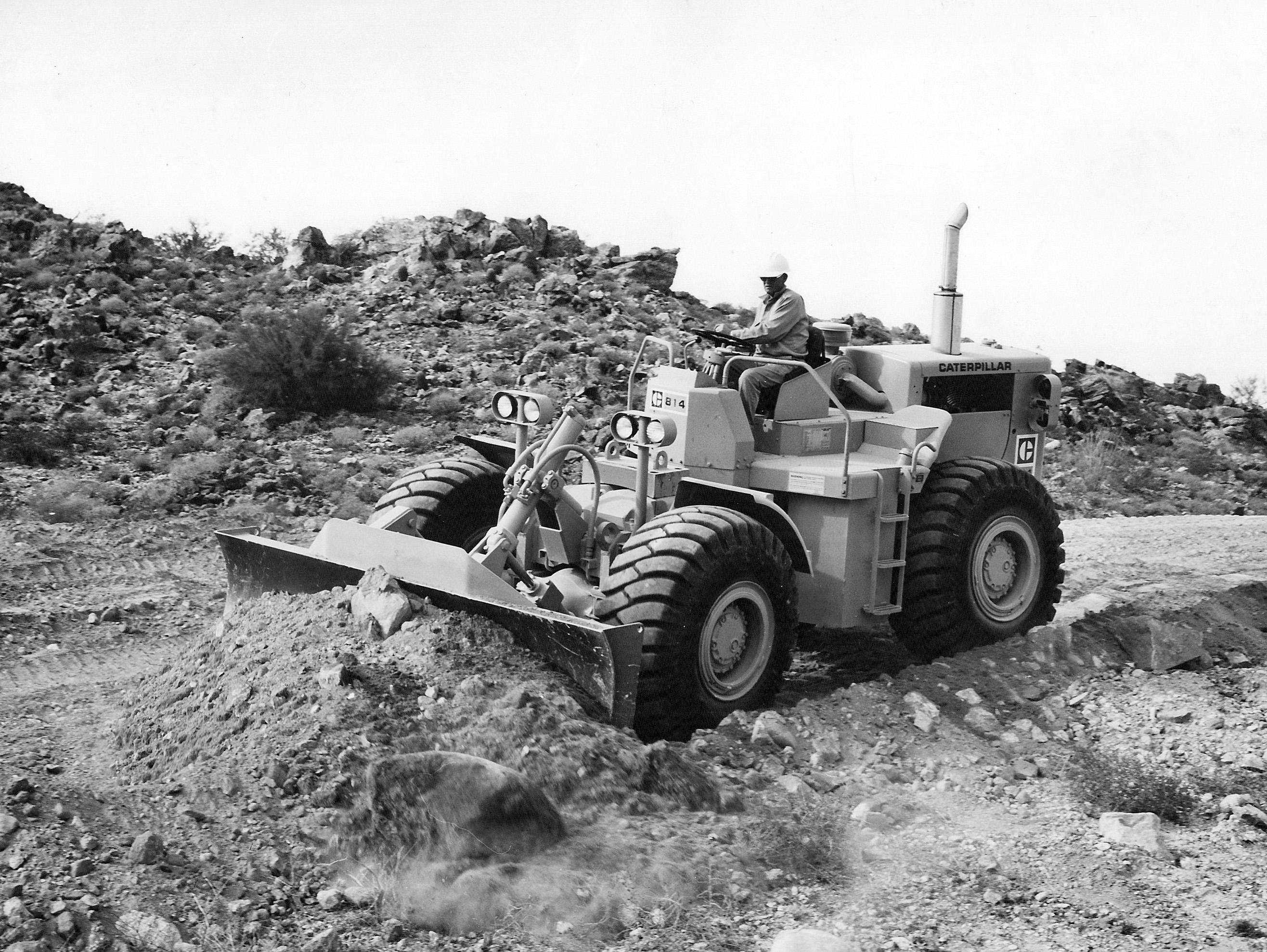 bulldozer caricatore cingolato combinazione Caterpillar-model-814-wheel-dozer-pit-quarry