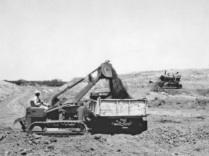 Deere Model 1010 loader and dozer at work. Pit & Quarry
