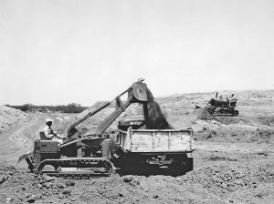 Deere Model 1010 loader and dozer at work. Pit & Quarry