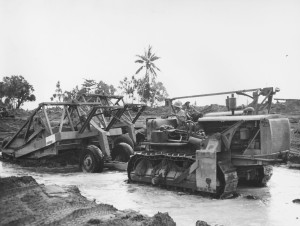 Caterpillar D-9 tractor and Wooldridge scraper. US Navy photo