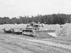 Sheepsfoot rollers pulled by Caterpillar D-7 dozer, Edgar Browning Image
